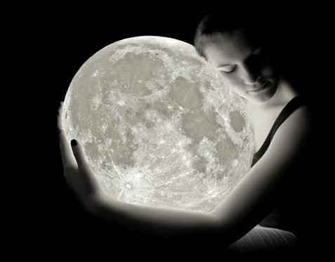 woman-holding-the-moon-e13519969922181
